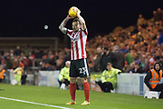 Lincoln City Defender Neal Eardley prepares for a throw in during the EFL Sky Bet League 2 match between Lincoln City and Coventry City at Sincil Bank, Lincoln, United Kingdom on 18 November 2017. Photo by Craig Zadoroznyj.