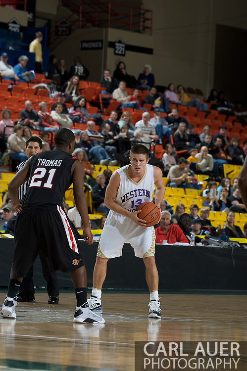 November 27, 2008: Western Carolina guard Brigham Waginger (13) brings the ball up the court against San Diego State's Matt Thomas (21) in the final game in the opening round of the 2008 Great Alaska Shootout at the Sullivan Arena