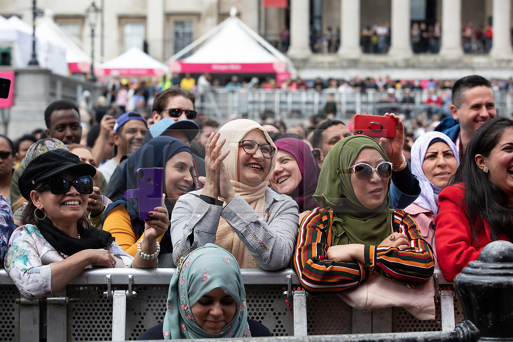 © Licensed to London News Pictures. 08/06/2019. London, UK. Revellers attend an event in Trafalgar Square to celebrate Eid ul-Fitr - the breaking of the fast. The festival marks the end of Ramadan, a holy month in the Muslim calendar when Muslims fast during the hours of daylight. This year, Eid occurred on Tuesday 4 June. Photo credit : Tom Nicholson/LNP