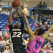 Towson Tigers Guard Tanisha McTiller (22) drives to the basket as Delaware Center Kelsey Buchanan (13) defends in the second half of a NCAA regular season Colonial Athletic Association conference game between Delaware and The Towson Tigers Sunday, Feb 16, 2014 at The Bob Carpenter Sports Convocation Center in Newark Delaware.