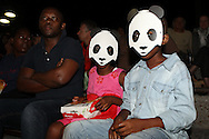 Young fans wearing panda masks during the WWF - Earth Hour Event held at the amphitheatre at the Victoria and Alfred Waterfront in Cape Town, South Africa on the 29th March 2014<br /> <br /> <br /> Photo by: RON GAUNT