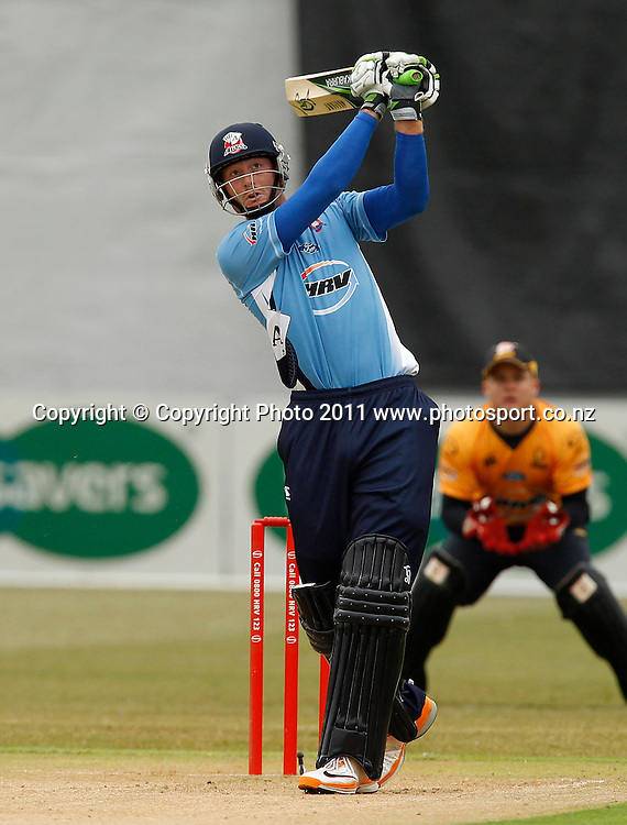 Martin Guptill of the Aces bats HRV Cup Cricket Twenty-20,  Auckland Aces v Wellington Firebirds, Colin Maiden Park Auckland, Sunday 18 December 2011. Photo: Simon Watts/www.photosport.co.nz