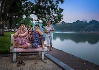 HANOI, VIETNAM - CIRCA SEPTEMBER 2014:  Vietnamese woman early morning in the Hoan Kiem Lake, in Hanoi.