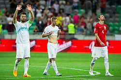 Bostjan Cesar of Slovenia, Ales Mertelj of Slovenia and Milivoje Novakovic of Slovenia look dejected after the EURO 2016 Qualifier Group E match between Slovenia and England at SRC Stozice on June 14, 2015 in Ljubljana, Slovenia. Photo by Vid Ponikvar / Sportida