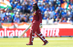 West Indies' Chris Gayle walks off after being caught by India's Kedar Jadhav, bowled by Mohammed Shami, during the ICC Cricket World Cup group stage match at Emirates Old Trafford, Manchester.