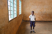 "Mindutulieni,Tanzania - 03.12.15  - Lowassa Almasi, 10, at Mindutulieni Primary School in Mindutulieni, Tanzania on December 3, 2015. ""I'd like to read some books,"" says Lowassa, whose school library is still under construction. Photo by Daniel Hayduk"