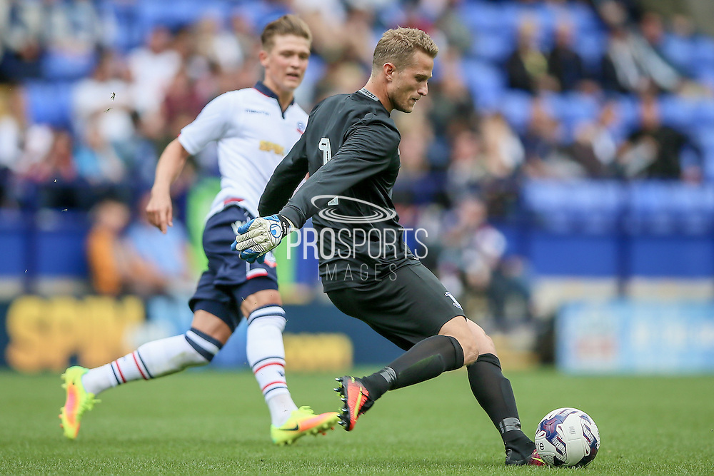 Anders Lindegaard (Preston North End) clears the ball under pressure from the Bolton attacker during the Pre-Season Friendly match between Bolton Wanderers and Preston North End at the Macron Stadium, Bolton, England on 30 July 2016. Photo by Mark P Doherty.