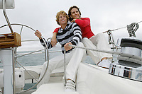 Young couple smiling on sailboat