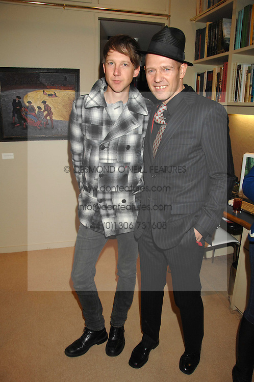 Left to right, JEFFERSON HACK and PAUL SIMONON at a private view of his recent paintings held at Thomas Williams Fine Art, 22 Old Bond Street, London on 15th April 2008.<br />