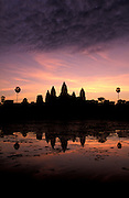 CAMBODIA - Angkor Wat.The imposing towers rise above the baray at dawn