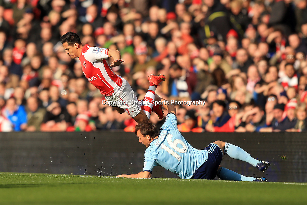14 March 2015 - Barclays Premier League - Arsenal v West Ham - Alexis Sanchez of Arsenal tangles with Mark Noble of West Ham - Photo: Marc Atkins / Offside.