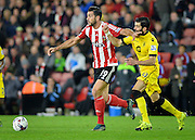 Southamptons Graziano Pelle takes on Aston Villas Jordan Amavi during the Capital One Cup match between Southampton and Aston Villa at the St Mary's Stadium, Southampton, England on 28 October 2015. Photo by Adam Rivers.