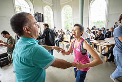 """13 August 2016, Norrbyskär, Umeå, Sweden: Maria Zaitunah (right) teaches Zumba fitness at the Kul-Tur Fest (""""Culture Festival""""). The event, which attracted hundreds of people, set out to offer a meeting place for Swedish culture and new forms of cultural expression, and featured baking competitions, dance workshops, book discussions, fingernail painting and music, among other things."""