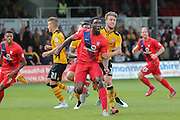 York City defender Femi Illesami attacks a corner ahead of Newport County defender Scott Barrow during the Sky Bet League 2 match between Newport County and York City at Rodney Parade, Newport, Wales on 5 September 2015. Photo by Simon Davies.