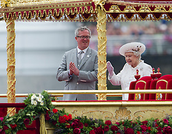 © Licensed to London News Pictures. 03/06/2012. London, UK. HRH The Queen waving as she inspects the Royal Barge Spirit of Chartwell at Cadogan Pier during the Jubilee Pageant on the River Thames, London on June 03,2012 as part of The Diamond Jubilee celebrations. Great Britain is celebrating the 60th  anniversary of the countries Monarch HRH Queen Elizabeth II accession to the throne . Photo credit : Ben Cawthra/LNP