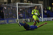 Lyle Taylor AFC Wimbledon and Luke McCormick (Goalkeeper) tussles up during the Johnstone's Paint Trophy match between AFC Wimbledon and Plymouth Argyle at the Cherry Red Records Stadium, Kingston, England on 1 September 2015. Photo by Stuart Butcher.