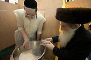 Israel, Tel Aviv, Preparing Matzah. The Rabbi inspecting the process. In order for the matza to be Kosher strict baking procedures must be followed, All hand made and under a strict watch of the Rabbi April 2005
