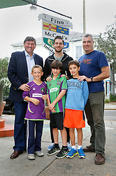 23 November 2015. Finn McCool's Irish Pub, New Orleans, Louisiana.<br /> Major League Soccer (MLS) star player Patrick Mullins of New York City FC poses for a photo with New Orleans Jesters Head Coach Kenny Farrell (l) and Steve Patterson (r) owner of Finn McCool's and young soccer players from the New orleans jesters Junior Academy.<br /> Photo©; Charlie Varley/varleypix.com
