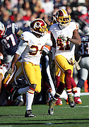 Washington Redskins strong safety Trenton Robinson (34) celebrates with Washington Redskins cornerback Will Blackmon (41) after Blackmon recovers a first quarter fumble by the New England Patriots during the 2015 week 9 regular season NFL football game against the New England Patriots on Sunday, Nov. 8, 2015 in Foxborough, Mass. The Patriots won the game 27-10. (©Paul Anthony Spinelli)
