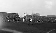 Bresnihan, left, kicks ahead over two Australians to Duggan, number 14, running around Australians,..Irish Rugby Football Union, Ireland v Australia, Tour Match, Landsdowne Road, Dublin, Ireland, Saturday 21st January, 1967,.21.1.1967, 1.21.1967,..Referee- M Joseph, Welsh Rugby Union, ..Score- Ireland 15 - 8 Australia, ..Irish Team, ..T J Kiernan,  Wearing number 15 Irish jersey, Full Back, Cork Constitution Rugby Football Club, Cork, Ireland,..A T A Duggan, Wearing number 14 Irish jersey, Right Wing, Landsdowne Rugby Football Club, Dublin, Ireland,..F P K Bresnihan, Wearing number 13 Irish jersey, Right Centre, University College Dublin Rugby Football Club, Dublin, Ireland, ..H H Rea, Wearing number 12 Irish jersey, Left Centre, Edinburgh University Rugby Football Club, Edinburgh, Scotland, ..P J McGrath,  Wearing number 11 Irish jersey, Left Wing, University college Cork Rugby Football Club, Cork, Ireland,  ..C M H Gibson, Wearing number 10 Irish jersey, Stand Off, N.I.F.C, Rugby Football Club, Belfast, Northern Ireland, ..B F Sherry, Wearing number 9 Irish jersey, Scrum Half, Terenure Rugby Football Club, Dublin, Ireland, ..K G Goodall, Wearing number 8 Irish jersey, Forward, Newcastle University Rugby Football Club, Newcastle, England, ..M G Doyle, Wearing number 7 Irish jersey, Forward, Edinburgh Wanderers Rugby Football Club, Edinburgh, Scotland, ..N Murphy, Wearing number 6 Irish jersey, Forward, Cork Constitution Rugby Football Club, Cork, Ireland,..M Molloy, Wearing number 5 Irish jersey, Forward, University College Galway Rugby Football Club, Galway, Ireland,  ..W J McBride, Wearing number 4 Irish jersey, Forward, Ballymena Rugby Football Club, Antrim, Northern Ireland,..P O'Callaghan, Wearing number 3 Irish jersey, Forward, Dolphin Rugby Football Club, Cork, Ireland, ..K W Kennedy, Wearing number 2 Irish jersey, Forward, C I Y M S Rugby Football Club, Belfast, Northern Ireland, ..T A Moroney, Wearing number 1 Irish jersey, Forward, University College Dubl