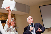 Aug, 25, 2009 -- SUN CITY, AZ: RON MAHONEY from Sun City, AZ, holds up a copy of the health care bill while SEN JOHN MCCAIN talks about it during the Town Hall meeting on health care sponsored by Sen McCain at Grace Bible Church in Sun City, AZ, Tuesday. More than 1,000 people attended the meeting in the church, which seats 700. Sun City is a staunchly Republican suburb of Phoenix and most of the crowd was opposed to President Obama health care reform efforts.     Photo by Jack Kurtz