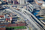 "East coast cities typically have more treacherous, crowded highway systems than their newer West Coast counterparts. Rush hour traffic on interstate 93 pours in and out of Boston's divided Tip O'Neill Tunnel. This tunnel was part of the $17 billion ""Big Dig"" project, built in part to depress the elevated Central Artery that cut the downtown off from the city's waterfront."