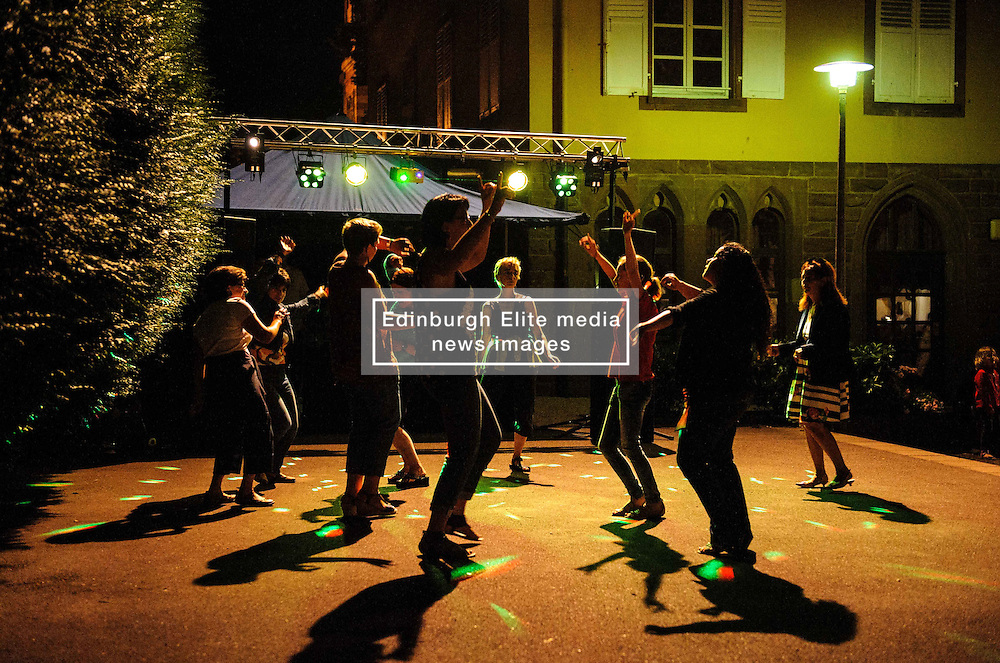 Late night dancing in the open air during Bastille day celebrations in the village of Neuwiller-les-Saverne, Alsace France.<br /> <br /> (c) Andrew Wilson | Edinburgh Elite media