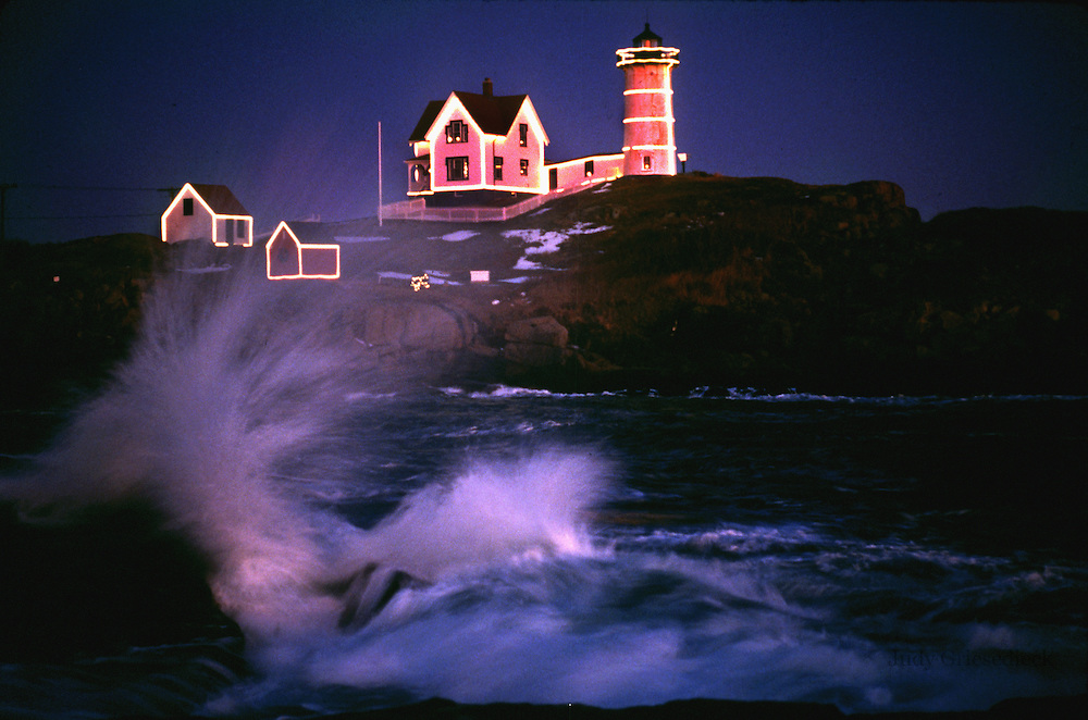 The Nubble Lighthouse in Maine is covered with festive lights during the holidays.