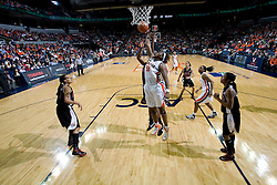Virginia center Aisha Mohammed (33) grabs a rebound against Maryland.  The Virginia Cavaliers women's basketball team fell to the #4 ranked Maryland Terrapins 74-62 at the John Paul Jones Arena in Charlottesville, VA on January 18, 2008.