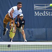 FELIX AUGER-ALLIASSIME hits a serve at the Rock Creek Tennis Center.