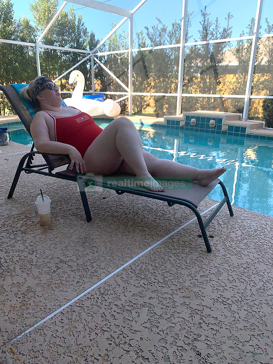 """EXCLUSIVE: *NO WEB UNTIL 1500 EDT 7TH APR* Mama June takes inspiration from Pamela Anderson - as she goes for a swim in a red bathing suit. The reality star, 40, slipped on a skimpy Baywatch style swimsuit to pose for these exclusive photographs showing her relaxing by her pool in Florida. The Honey Boo Bo star and mum-of-four famously wore the swimwear after shedding an incredible 290lbs. With the help of a personal trainer and a strict diet, June - who once weighed 462 lbs - managed to get her weight down too 168lbs. But a source close to the larger-than-life personality revealed that June has recently gained more weight and has been slipping into bad habits during the COVID-19 quarantine. The insider said: """"June has recently put on 45lbs and is currently 210lbs. """"Unfortunately after doing so well she has been struggling with her weight and eating a lot during quarantine The hope is that she soon remembers how far she came and quickly gets back on a healthy path."""" June's incredible transformation was captured by cameras on the hit show 'From Hot to Not' after she underwent a $75,000gastric sleeve surgery, breast augmentation and skin removal surgery on her """"bat wings,"""" stomach and """"turkey neck."""". 03 Apr 2020 Pictured: Mama June. Photo credit: MEGA TheMegaAgency.com +1 888 505 6342"""