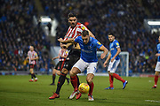 Portsmouth Defender, Lee Brown (3) holds off his man during the EFL Sky Bet League 1 match between Portsmouth and Sunderland at Fratton Park, Portsmouth, England on 22 December 2018.