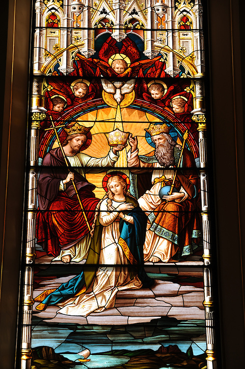Stained glass image depicts the coronation of Mary. (Sam Lucero photo)