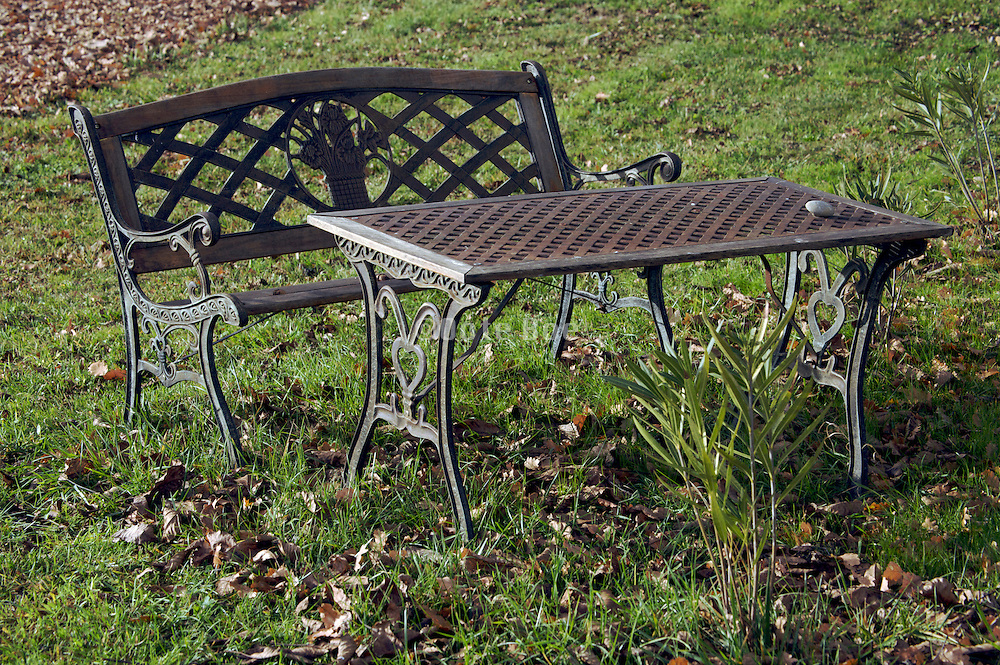 outdoor garden bench during fall season