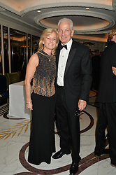 DAVID GOWER and his wife THORUNN at the David Shepherd Wildlife Foundation 30th anniversary Wildlife Ball at The Dorchester, Park Lane, London on 10th October 2014.