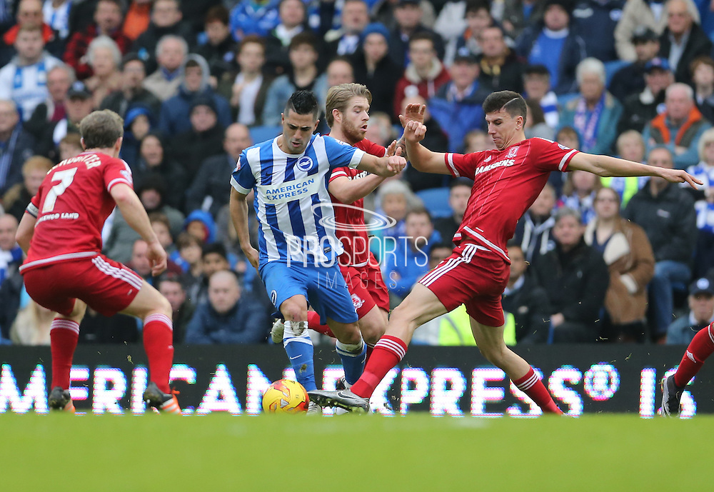 Brighton central midfielder, Beram Kayal (7) tackled by Middlesbrough FC defender Daniel Ayaladuring the Sky Bet Championship match between Brighton and Hove Albion and Middlesbrough at the American Express Community Stadium, Brighton and Hove, England on 19 December 2015.