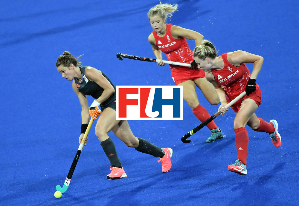 Britain's Georgie Twigg (C) and Britain's Hollie Webb (R) chase Netherlands' Ellen Hoog during the women's Gold medal hockey Netherlands vs Britain match of the Rio 2016 Olympics Games at the Olympic Hockey Centre in Rio de Janeiro on August 19, 2016. / AFP / Pascal GUYOT        (Photo credit should read PASCAL GUYOT/AFP/Getty Images)