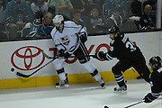 May 26, 2013; San Jose, CA, USA; Los Angeles Kings right wing Justin Williams (14) controls the puck against San Jose Sharks center Logan Couture (39) during the first period in game six of the second round of the 2013 Stanley Cup Playoffs at HP Pavilion.