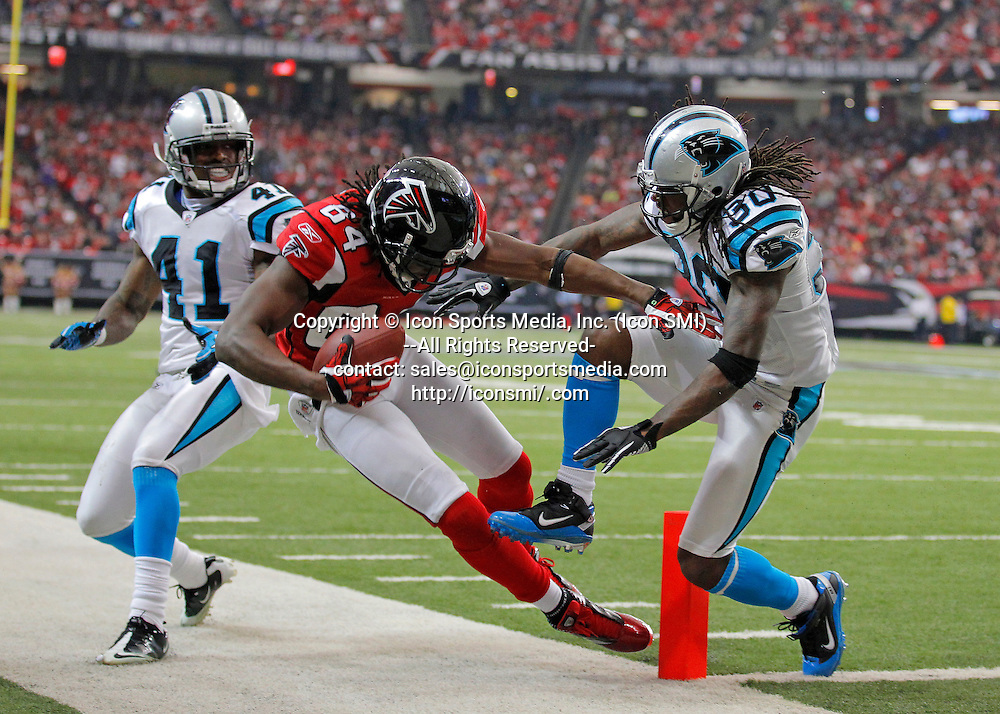 02 January 2011: Atlanta Falcons wide receiver Roddy White (84) dives in for a touchdown over Carolina Panthers safety Charles Godfrey (30) in the Atlanta Falcons 31-10 victory over the Carolina Panthers at the Georgia Dome in Atlanta Georgia.