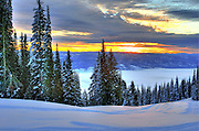 USA, Idaho, Valley County, Sunrise over a fog covered Long Valley from West Mountains