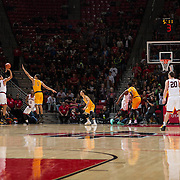 31 January 2017:  The San Diego State Aztecs men's basketball team hosts Wyoming Tuesday night at Viejas Arena. San Diego State guard Trey Kell (3) attempts a three point shot over Wyoming guard Justin James (1) in the first half. The Aztecs lead the Cowboys 31-27 at half time. www.sdsuaztecphotos.com