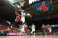 DALLAS, TX - FEBRUARY 19: Will Cummings #2 of the Temple Owls drives to the basket against Ryan Manuel #1 of the SMU Mustangs on February 19, 2015 at Moody Coliseum in Dallas, Texas.  (Photo by Cooper Neill/Getty Images) *** Local Caption *** Will Cummings; Ryan Manuel