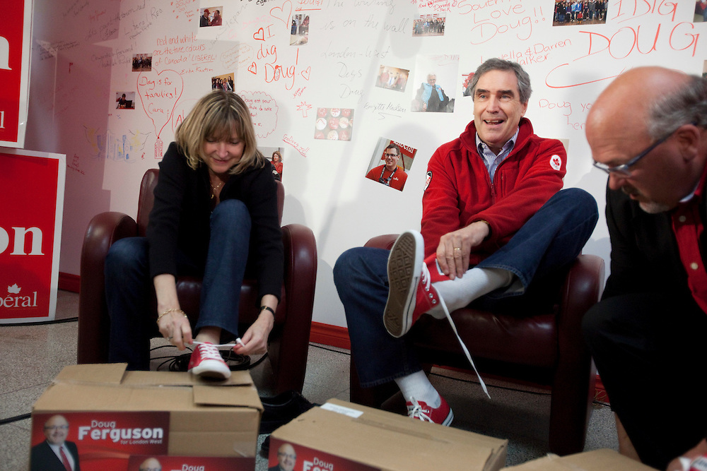 Liberal leader Michael Ignatieff and his wife Zsuzsanna Zsohar try on some new red converse shoes for the last days at the campaign during a stop in London, Ontario, Friday April 29, 2011.<br /> REUTERS/Geoff Robins (CANADA)