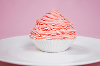 Pink cupcake on plate