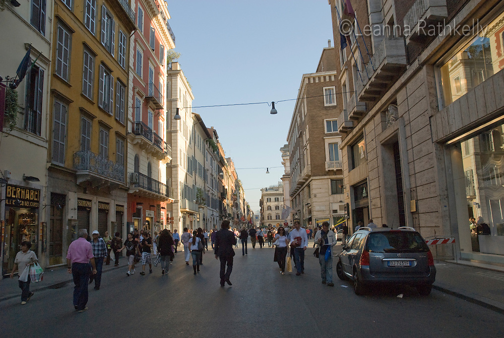 Via del Corso, a main route in the shopping district near the Spanish Steps in downtown Rome, Italy, is filled with people.