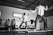 Minors incarcerated at a nearby prison undertake exercises during a fencing session at a studio in the city of Thiès, Senegal on April 29, 2015. Supported by OSIWA, organisation 'Pour un sourire d'enfant'  has implemented the sport of fencing as a form of restorative justice in a minor's prison for males and females in the city of Thiès, Senegal. This innovative judicial method works as a restorative rather than punitive approach to justice. Fencing is an effective method for helping incarcerated young people build self-confidence and respect (both for themselves and others), and engender discipline and determination.