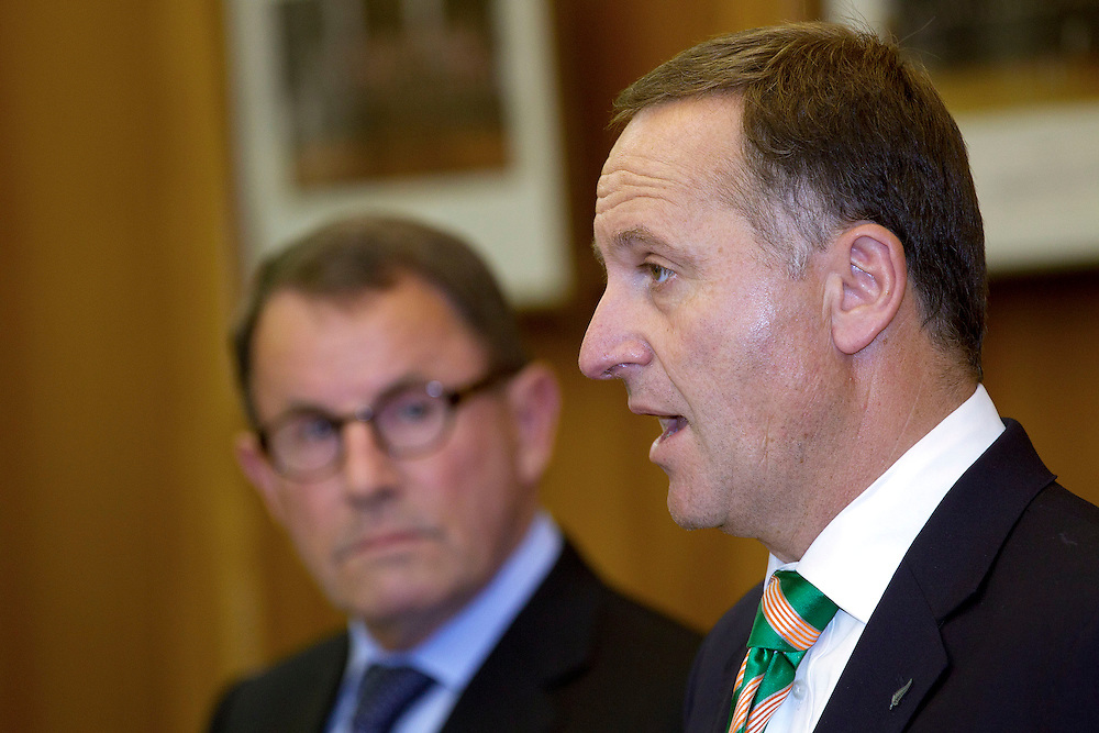 New Zealand Prime Minister John Key, right, speaks to the media with ACT MP John Banks after signing a coalition agreement at Parliament in Wellington, New Zealand, Monday, December 05, 2011. Credit: SNPA / Marty Melville
