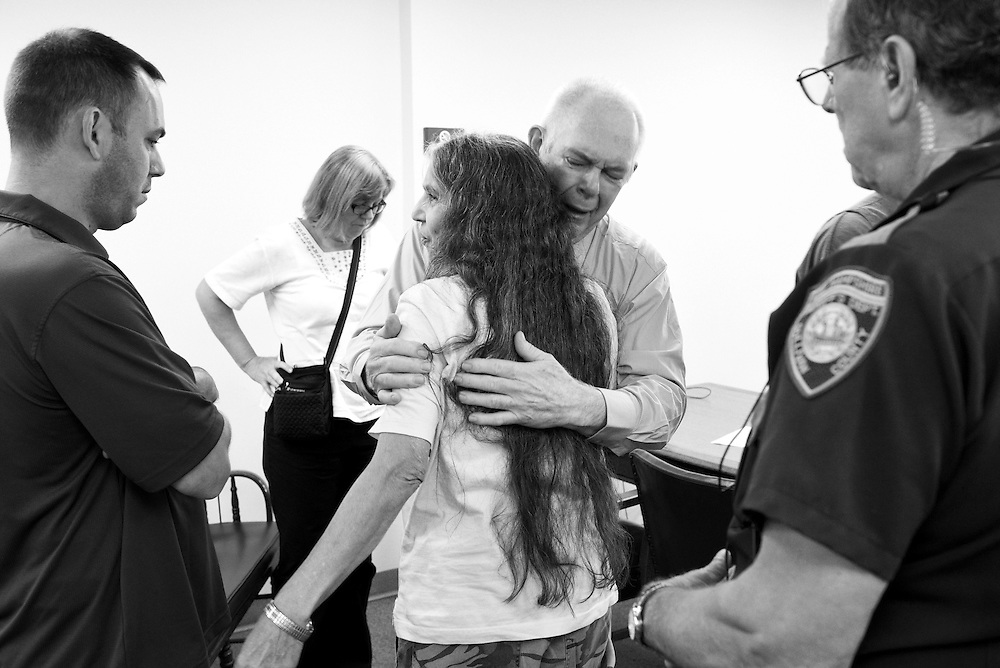 After pleading guilty to aggravated felonious sexual assault against a girl under 13, Curtis Wyman, of Cornish, is given a moment to say goodbye to his wife Diana, middle, son Curtis Jr., left, and sister, back left, before being escorted out of Sullivan County Superior Court by Sheriff's Deputy William Ball, right, Monday, August 3, 2015. Wyman was sentenced to six-and-a-half to 15 years in prison. (Valley News - James M. Patterson)<br /> Copyright &copy; Valley News. May not be reprinted or used online without permission. Send requests to permission@vnews.com.