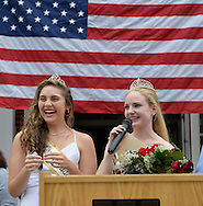 Wantagh, New York, USA. 4th July 2015. KAYLA KNIGHT, Miss Wantagh 2014, smiles next to newly crowned KERI BALNIS, Miss Wantagh 2015, who is speaking at the podium, at The Miss Wantagh Pageant ceremony, a long-time Independence Day tradition on Long Island, held at Wantagh School after the town's July 4th Parade. Since 1956, the Miss Wantagh Pageant, which is not a beauty pageant, crowns a high school student based mainly on academic excellence and community service.
