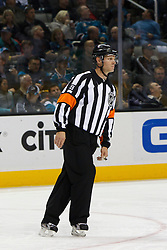 Dec 3, 2011; San Jose, CA, USA; NHL referee Gord Dwyer (19) before a face off between the San Jose Sharks and the Florida Panthers during the second period at HP Pavilion. Florida defeated San Jose 5-3. Mandatory Credit: Jason O. Watson-US PRESSWIRE
